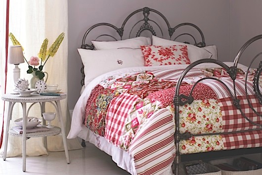 A patchwork quilt on a bed
