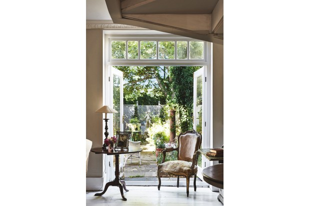 The living room's french windows open out to the patio