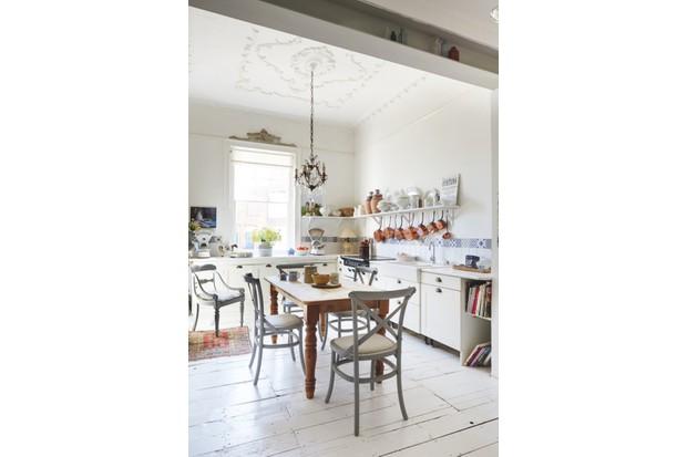 A pine table is the focus of the kitchen