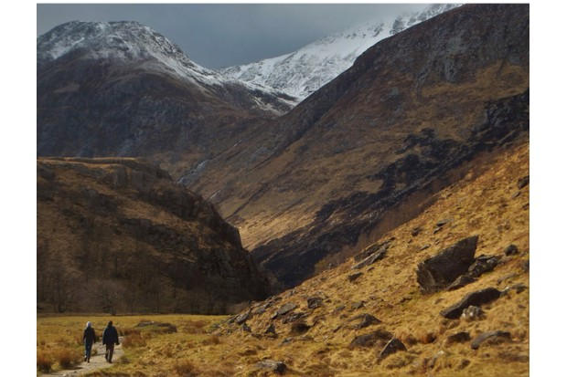 Hikers walking on a path up Glen Nevis