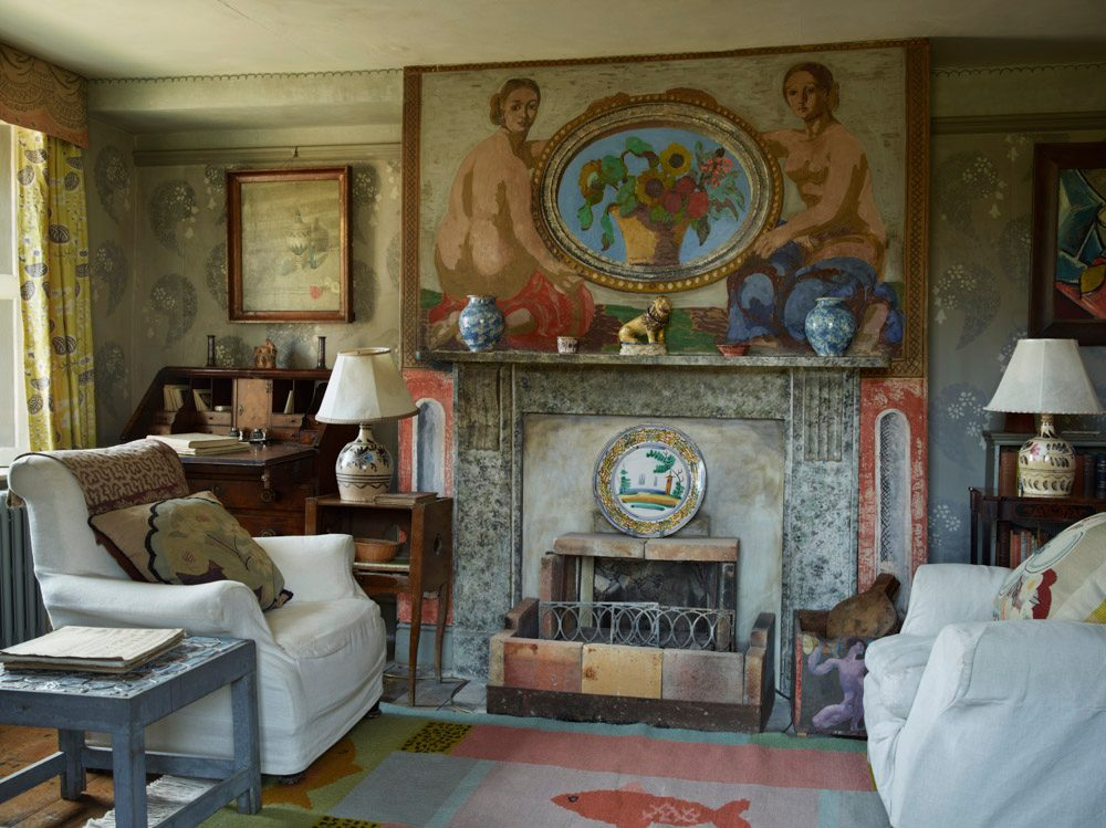 The Garden Room Of The Charleston Farmhouse. The Fireplace Is Made Of  Marble And Decorated