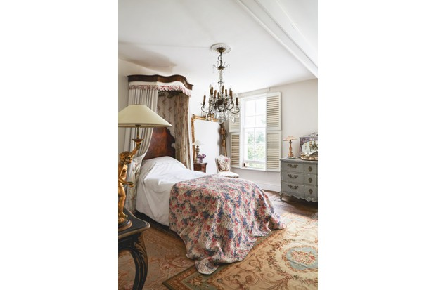 An antique floral bed with a canopy