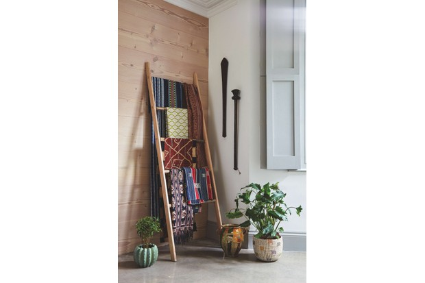 A tribal ladder, with tribal fabrics hung over it