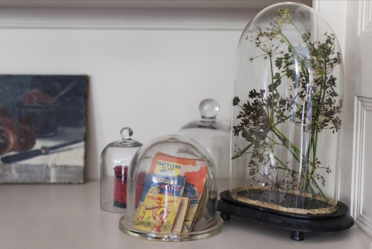 Vintage and antique items displayed in glass display cases