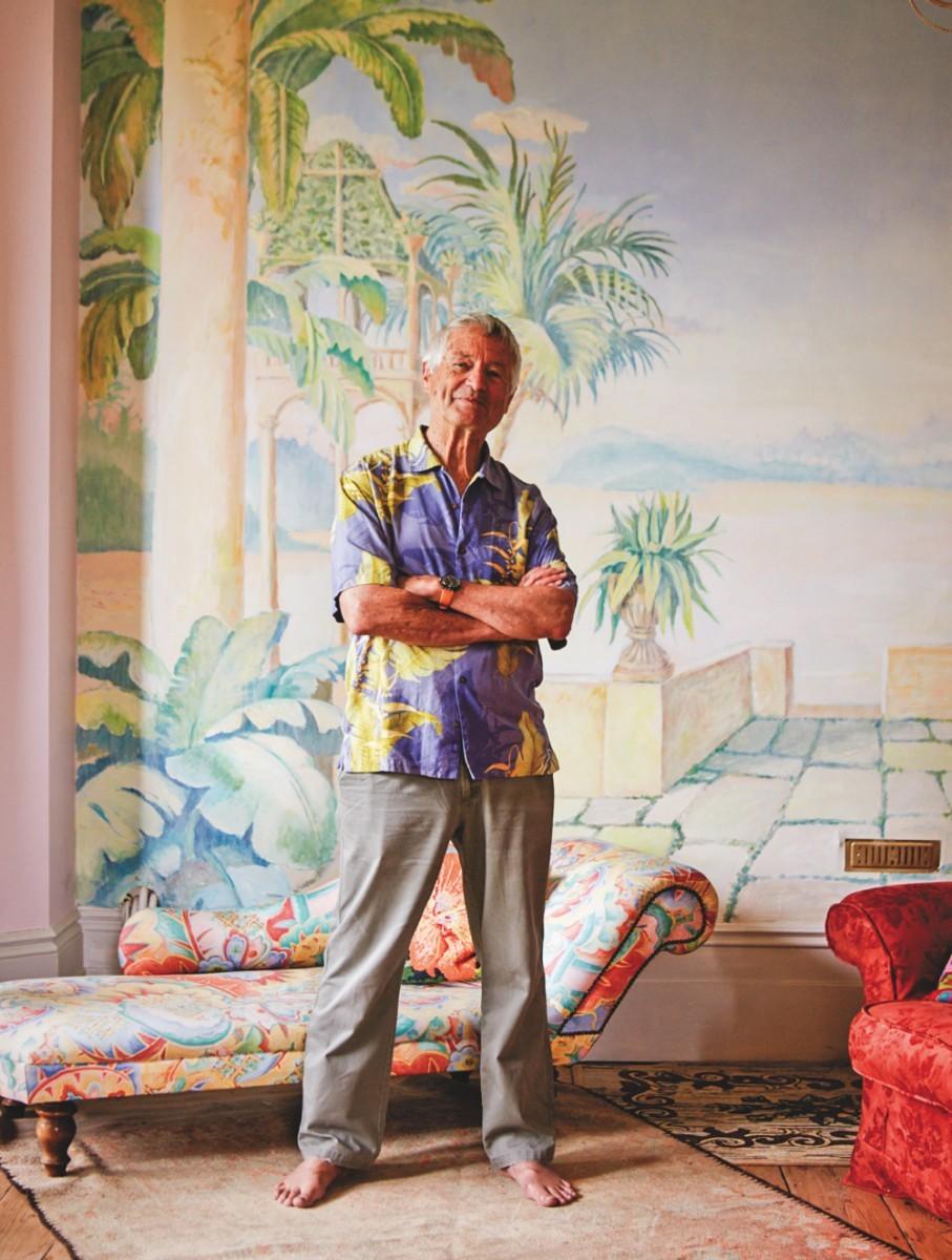 A portrait of Kaffe Fassett in a bold Hawaiian shirt