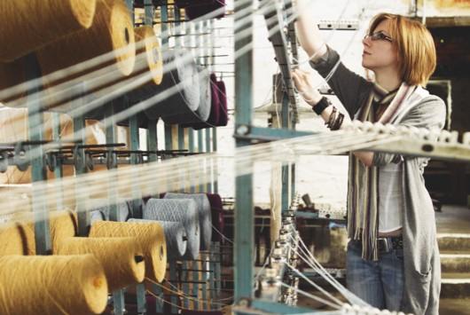 An employee at work on a Melin Tregwynt loom