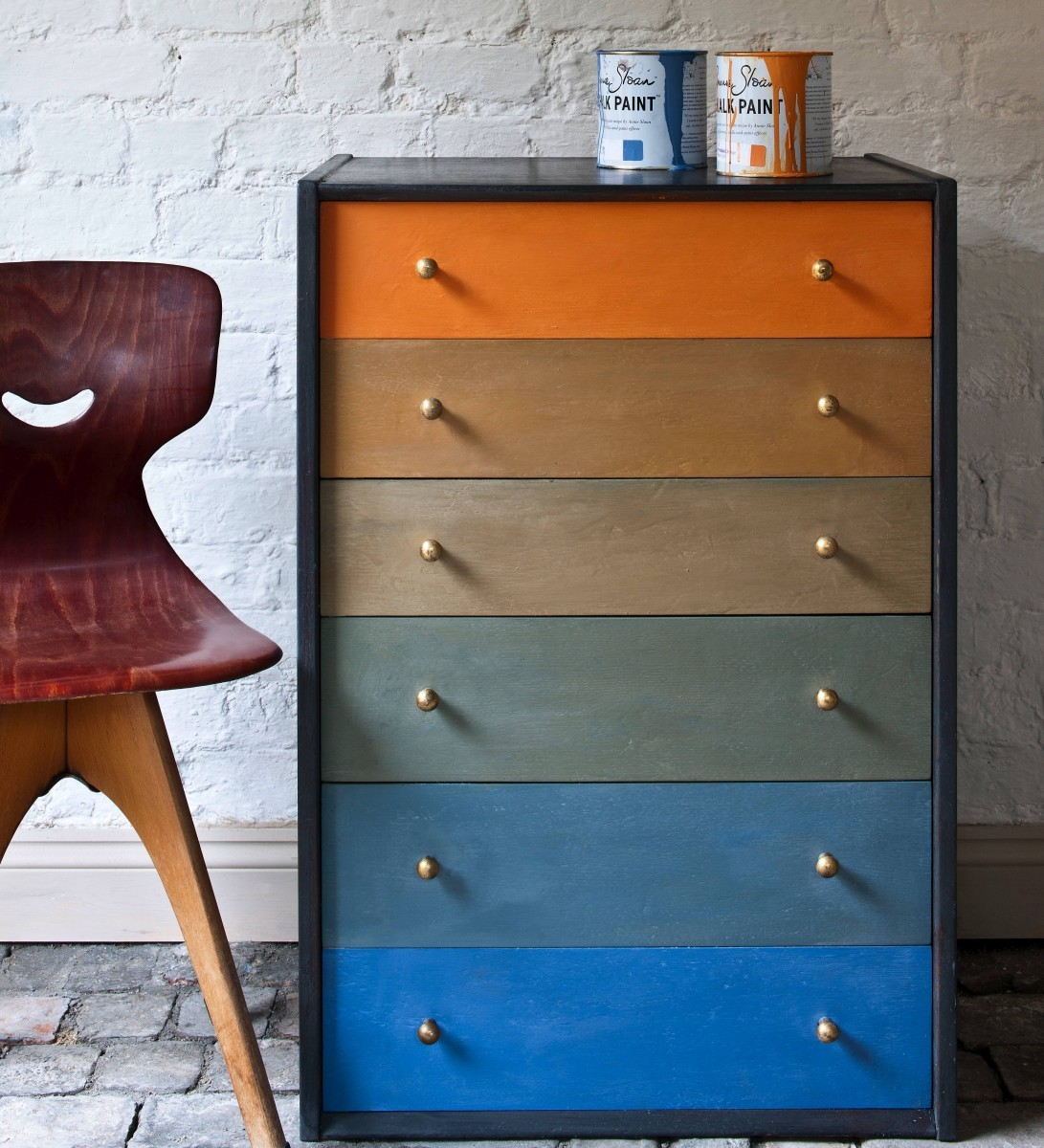 An upcycled chest of drawers painted in the style of Paul Klee