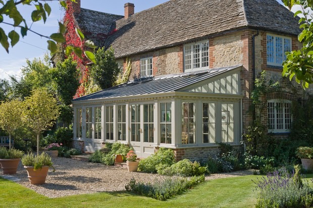 A victorian-style garden room attached to a farmhouse