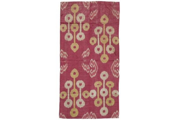 A swatch of red and yellow Ikat fabric
