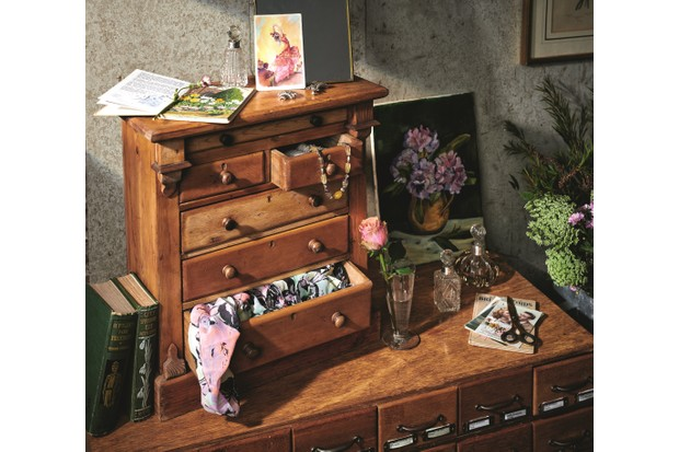 A vintage drawer unit on a dressing table used to store make up, jewellery and scarves