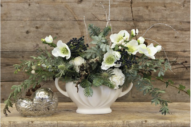 A Constance Spry vase filled with festive blooms and greenery