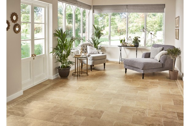 Warm brown stone flooring in a classic garden room