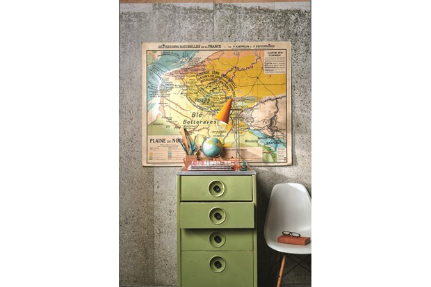 A vintage orange wire tray atop a green metal filing cabinet.