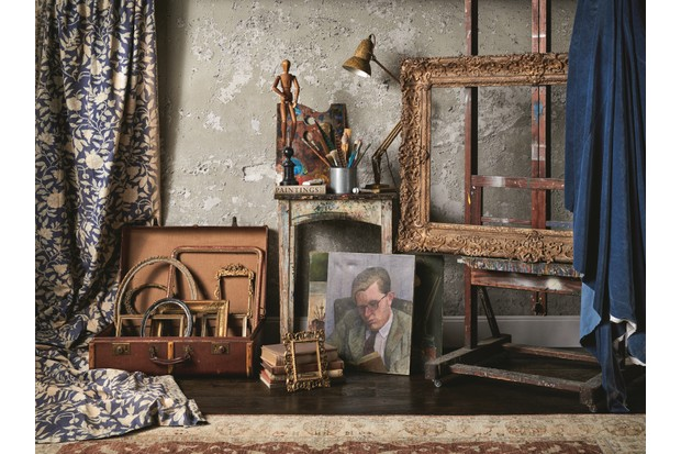 An array of antique gilded frames, paintings and easels against an exposed concrete wall