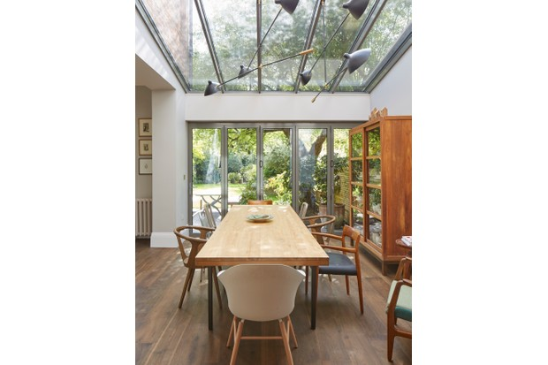 Bespoke aluminium and glass lean-to with bi-folding and patio doors. A similar structure by Apropos costs from £32,000.