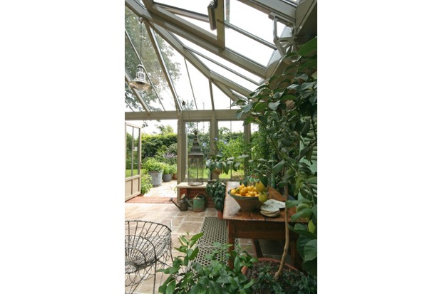 An old-fashioned style garden room filled with plants