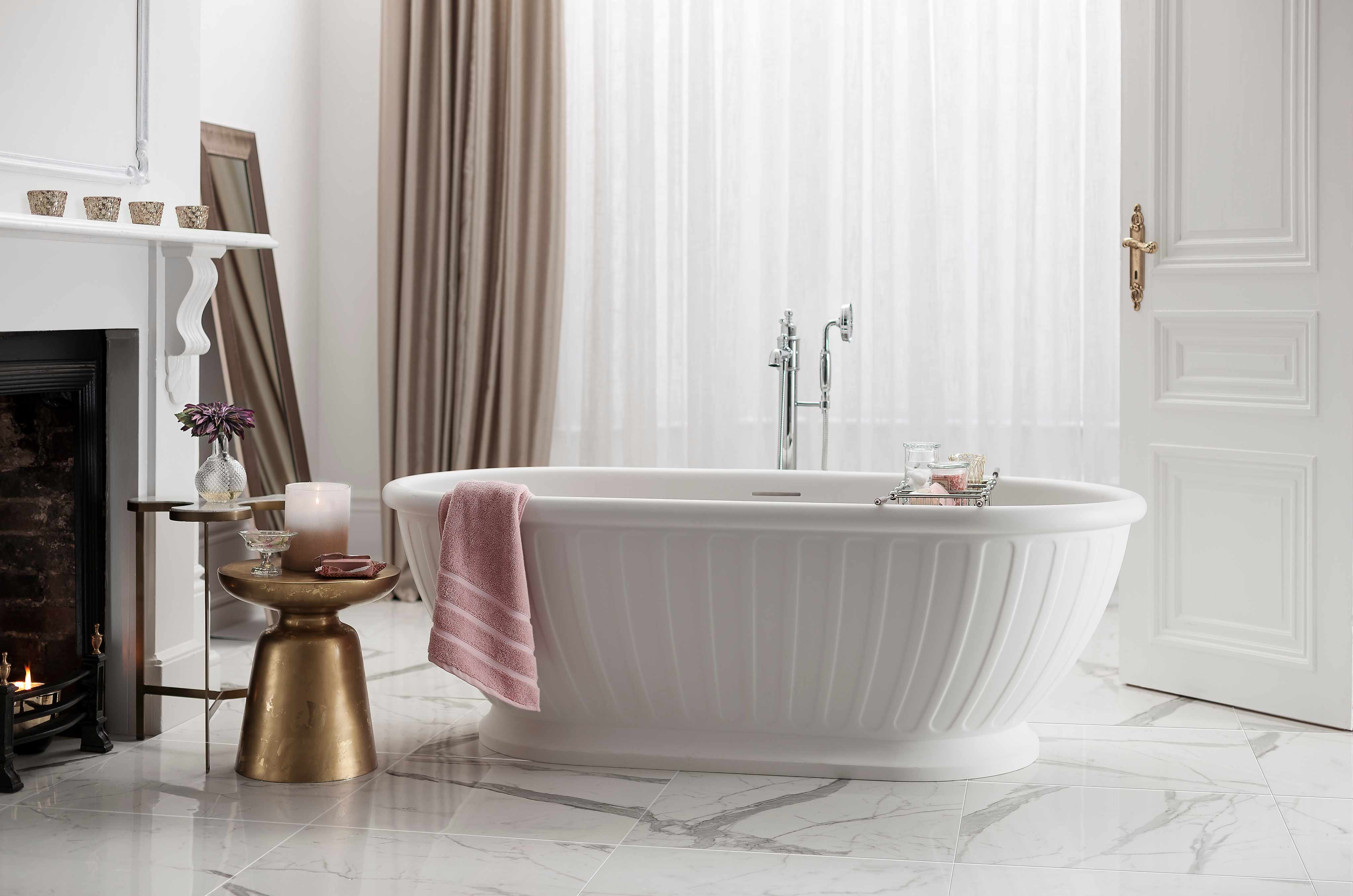 A ripped Burlington bath with a blush pink towel
