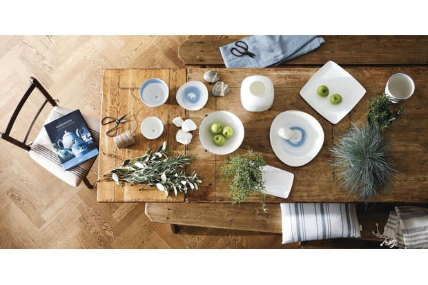 A rustic farmhouse table laden with modern Wedgwood designs