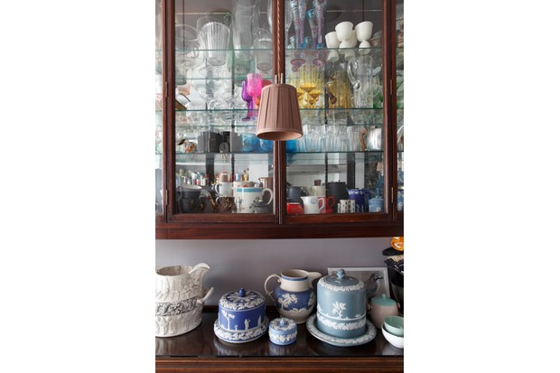 Wedgewood Jasperware on kitchen cabinet beneath another cabinet filled with glassware