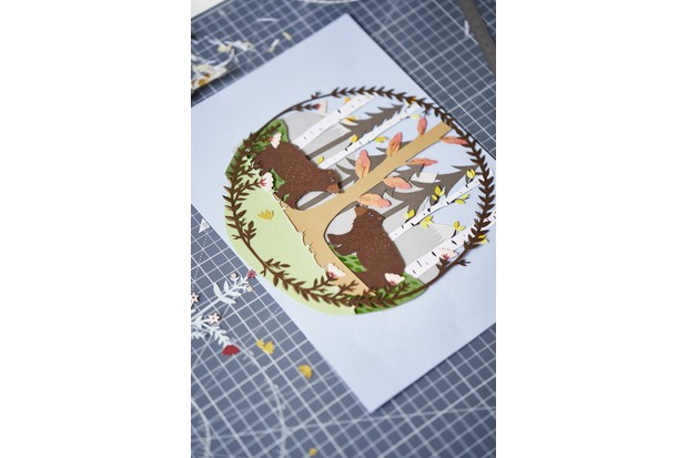 One of Jessica's paper cut designs featuring bears in a woodland scene