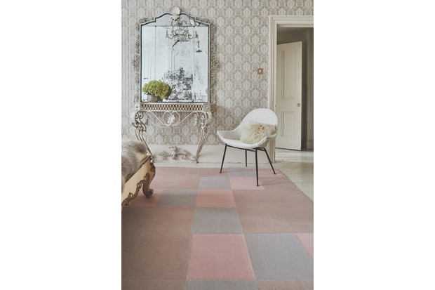 Roger Oates rug next to antique mirror and wicker chair