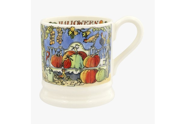 A midnight blue and white halloween mug from Emma Bridgewater featuring painted pumpkins