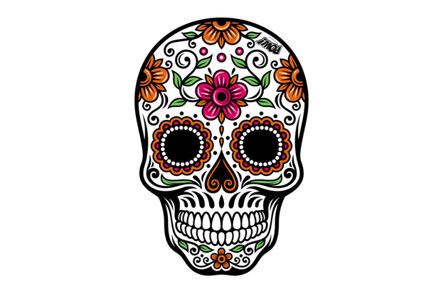 A colourful skull-shaped door mat featuring flowers and leaves.