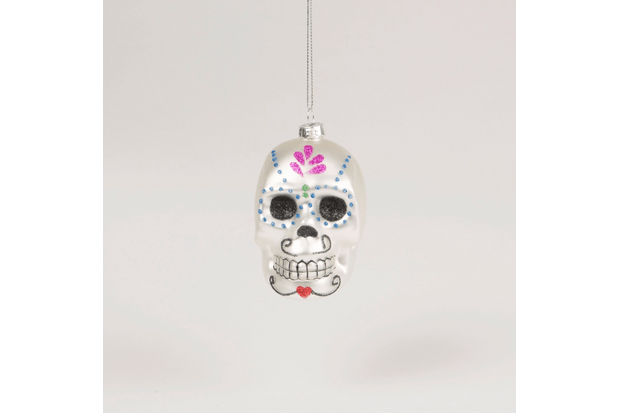 A glittery bauble shaped like a traditional Day of the Dead sugar skull.