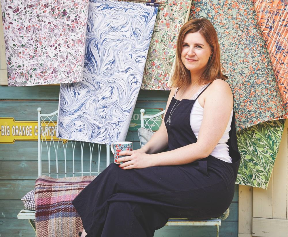 Jemma Lewis sat outside her studio