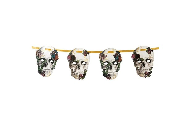 A decorative paper garland featuring skulls adorned with baroque-style flowers threaded onto a gold ribbon.