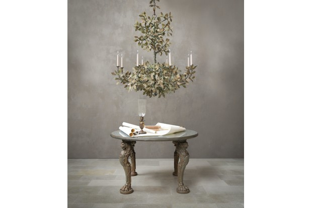 Standard Oak Tree metalwork chandelier, £12,720, Cox London above an antique table