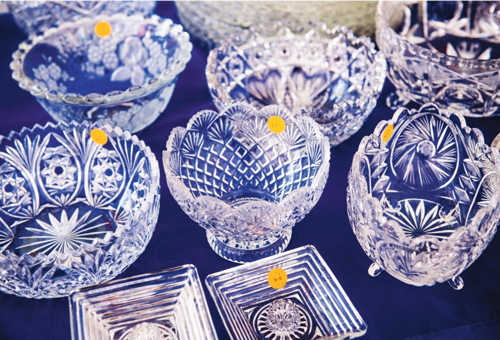 An array of antique cut crystal bowls on a midnight blue tablecloth