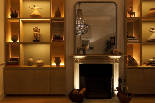 Here, shelves are backlit with Contour HD27 LED strip, £117 per m, while the fireplace is uplit with Lucca, £110, both from John Cullen Lighting.