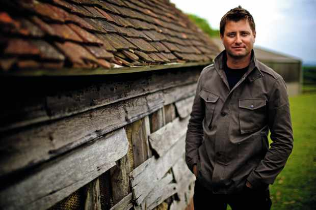 George Clarke stood outside