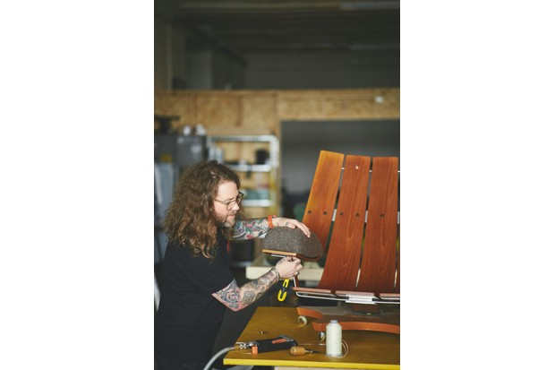 Simion Hawtin-Smith working on a G Plan Housemaster chair