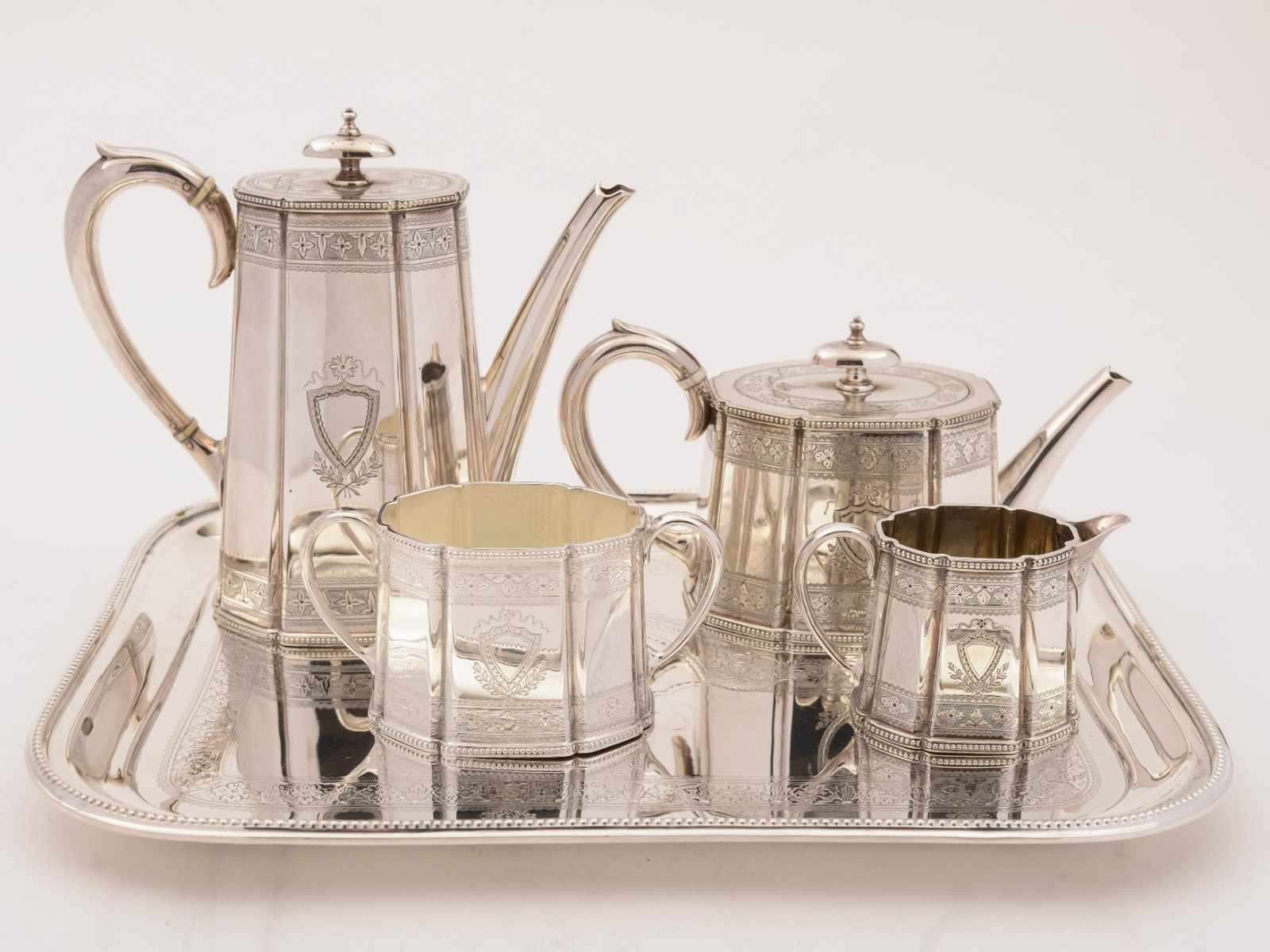 A silver tea and coffee set on a silver tray