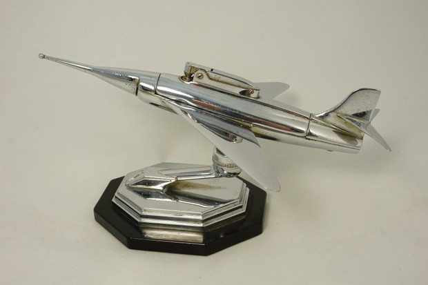 Chrome table lighter in shape of jet plane