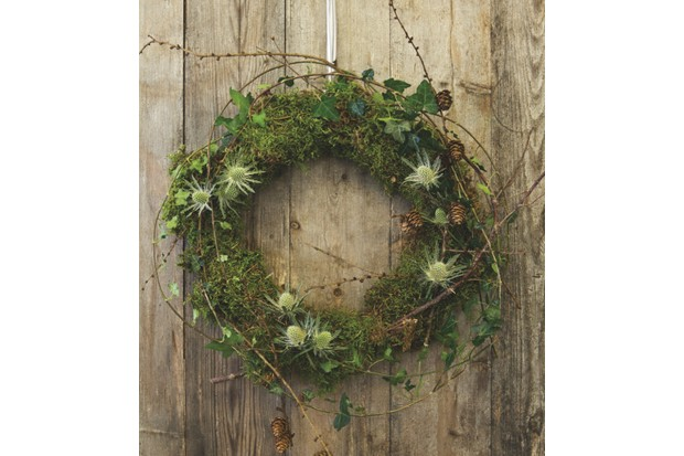 Step 1 - Twigs, dampended moss, ivy and fresh foraged greenery secured to the base of a wreath frame