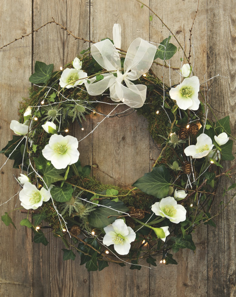 Homemade Christmas wreath with fresh flowers and foraged greenery