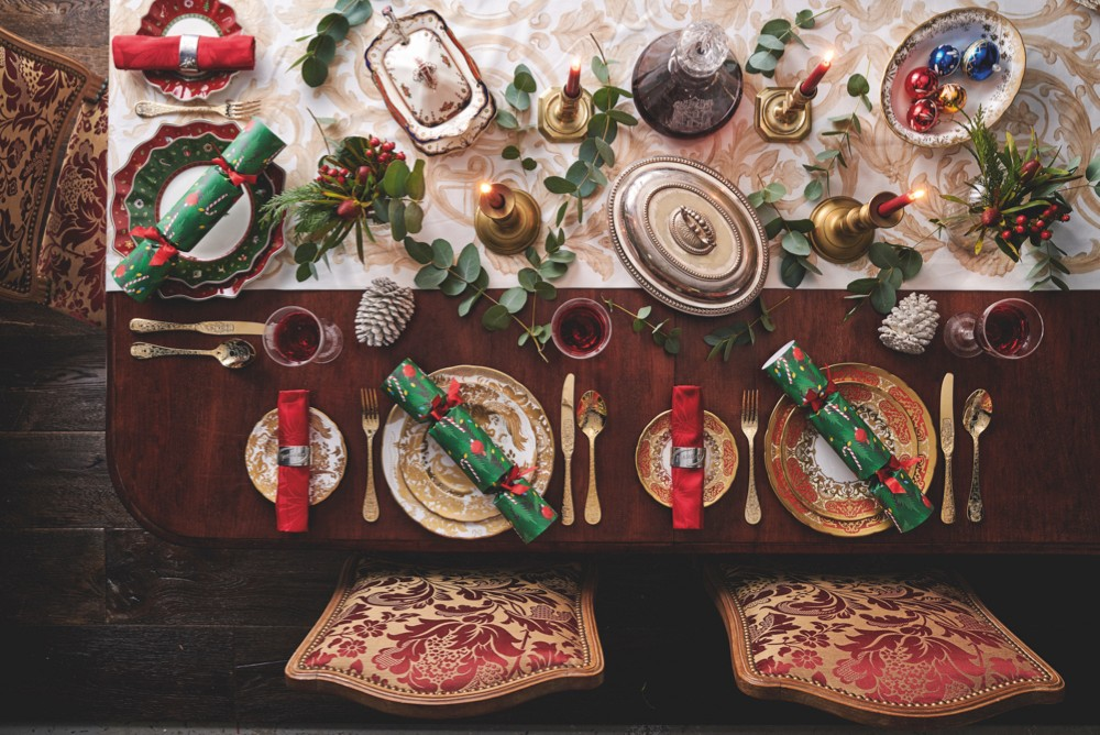 A traditional combination of red and green table decorations. A classic and sophisticated look with gold and silver element and glassware.
