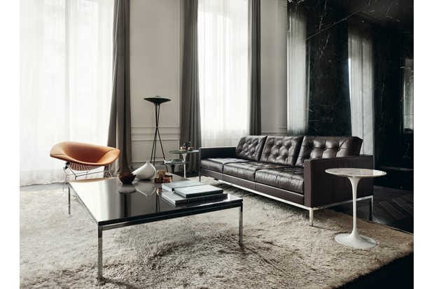 A luxury living room set featuring several of Florence Knoll's iconic original designs, including her 'Relax sofa in dark brown 'Venezia' leather and 'Low Table' with lacquer top