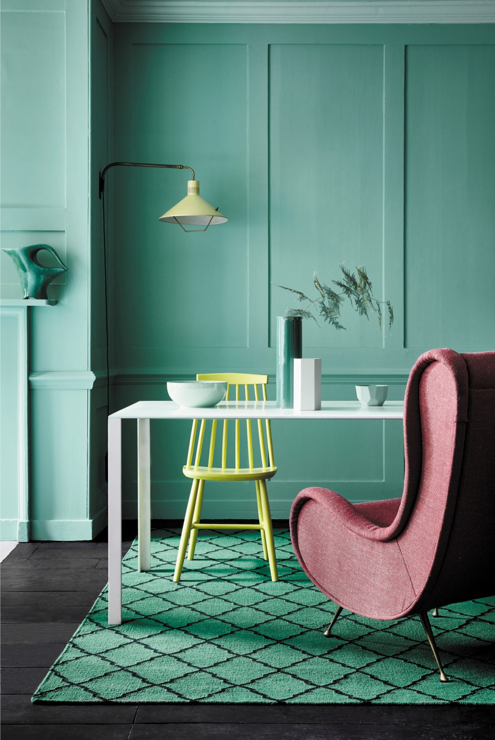 Little Greene 2018 Pall Mall wall paint in a room set with a white dining room table, pink luxe armchair and complimentary accessories