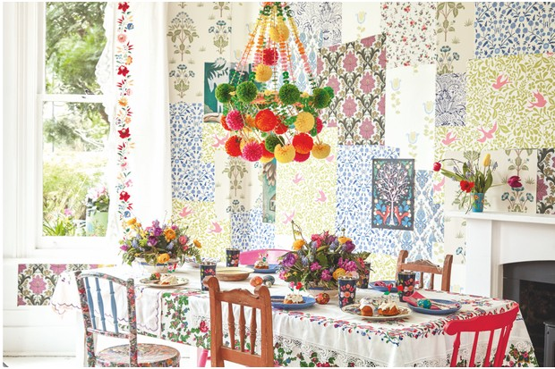 A colourful dining room filled with an array of wallpaper designs to create a patchwork effect