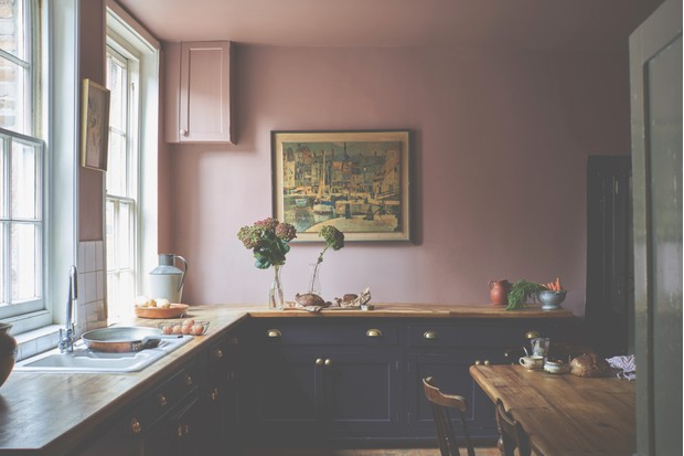 A classic shaker kitchen in black against blush pink walls