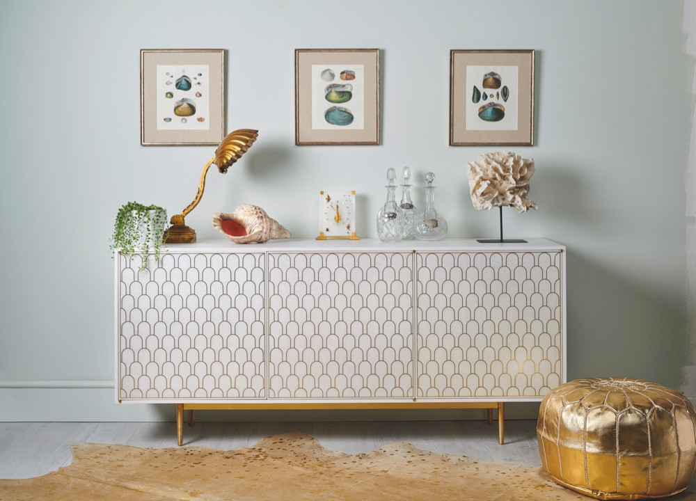 Chic white and gold sideboard styled with oceanic antiques