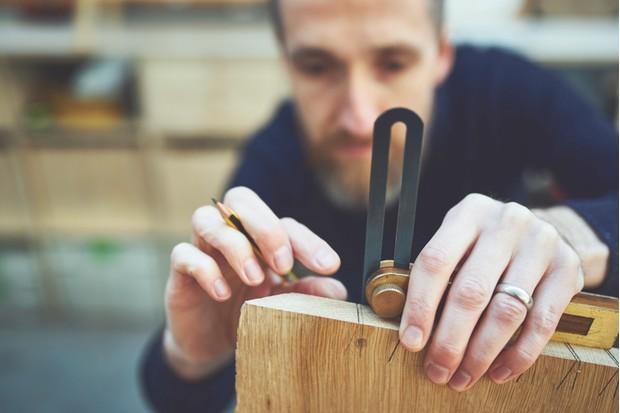 Ben from Knotch Design working to create an English oak writing desk