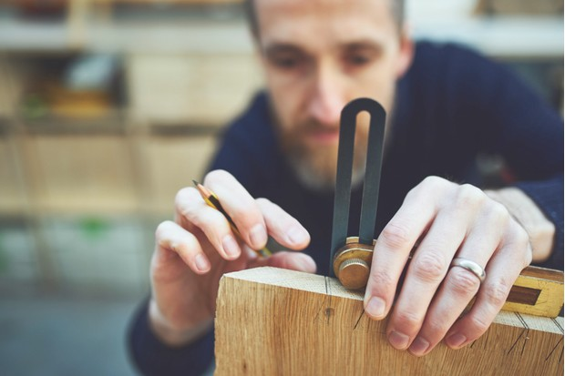 Ben from Knotch Design working to create an English oak writing desk