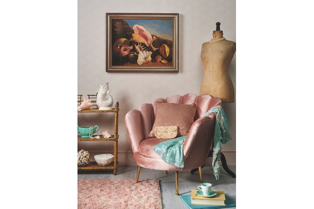 A luxury dressing room set up with a pink petal chair