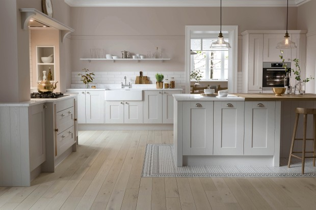 The Shaker Forest kitchen in Shadow from Wren Kitchens, which features a practical ceramic double Belfast sink surrounded by an engineered quartz worktop. Forest kitchen units as seen here cost around £4,000.