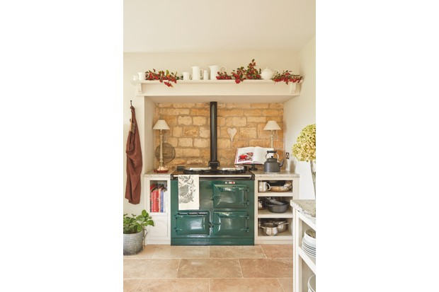 A green AGA in a cosy country kitchen